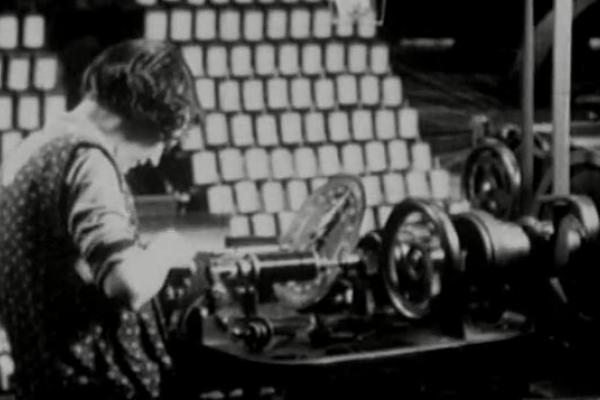 Black and white image of a female worker in the textile industry.