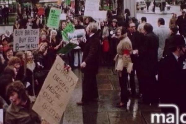 Image of a protest, urging the public to buy British made textiles.