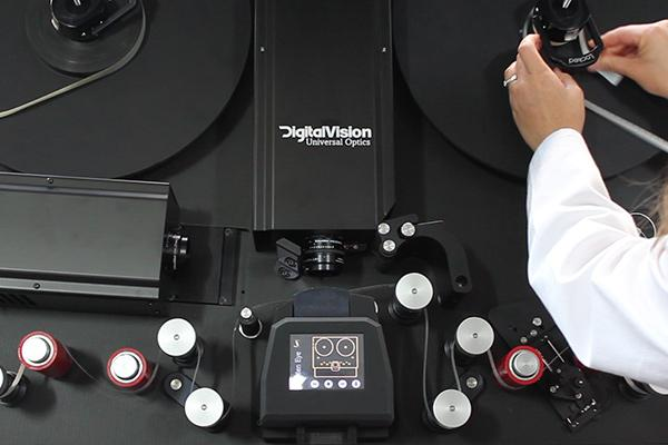 An image of 16mm film being laced up on MACE's Golden Eye 4 film scanner.