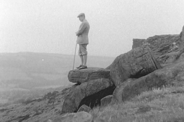 Image of a man overlooking the peak district.