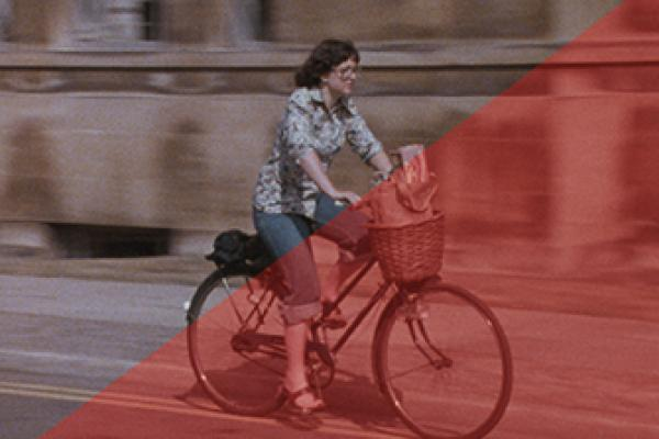 An example of how the software we use can bring life back to a film suffering from colour fade.  The right hand triangle in the image of a young woman on a bicycle is the colour of the original film.  The triangle on the left is after the image has been colour corrected.