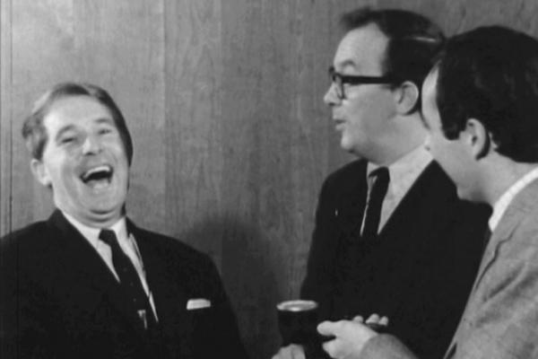 Black and white image of Morecambe and Wise being interviewed.