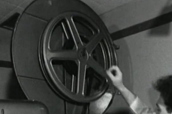 Black and white image of a film projector wheel.