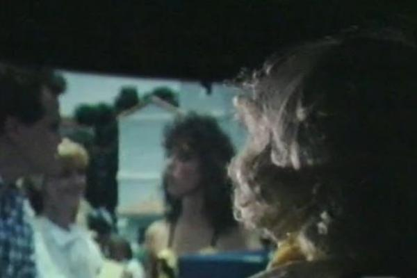 Behind the shoulder image of a women at the cinema.