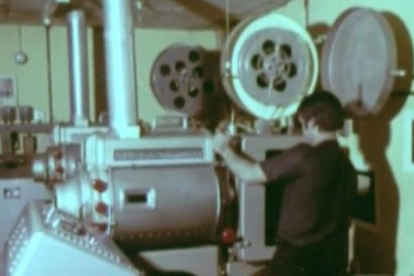 Image of a projectionist and projector.