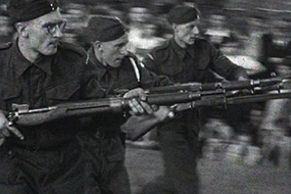 A black and white still image from a 16mm home movie showing Home Guard soldiers during an exercise at Aston Park, Birmingham.