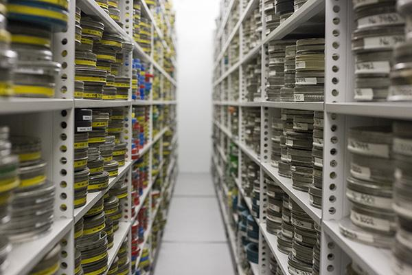 An image of film cans on shelves in MACE's purpose built film and video store.