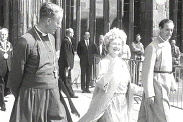 Black and white image of a royal visit in Coventry.
