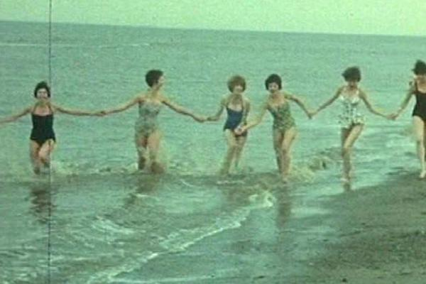 Image of people running along the seaside.