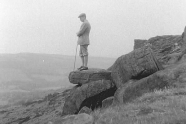Black and white image of a man overlooking the Peak District.
