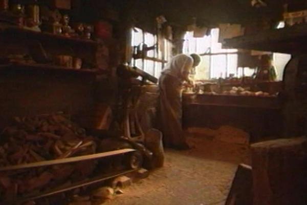 Image of a craftsman at his workshop.