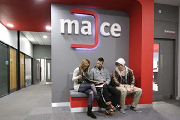 Image of Students sitting outside the MACE office.