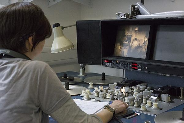 An image of a MACE curator using our eight plate Steenbeck to view 16mm film.