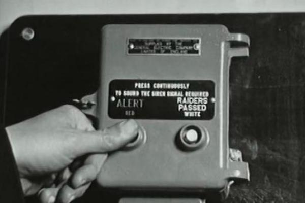 Black and white image of a siren control box.