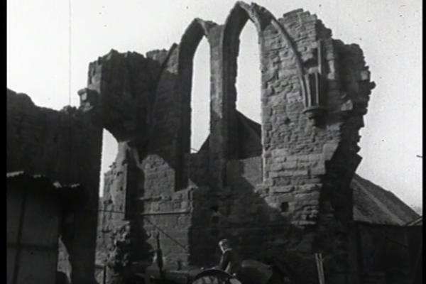 Black and white image of a dilapidated church.
