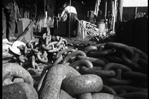 Black and white image of industrial chains.