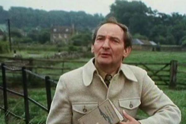 Image of a TV reporter in the countryside.