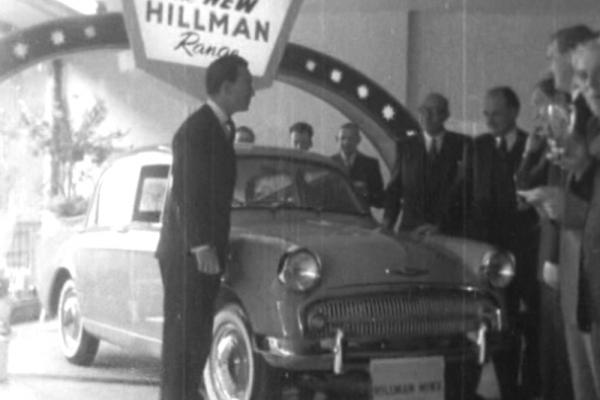 Black and white image of the Hillman Husky at a car dealer.